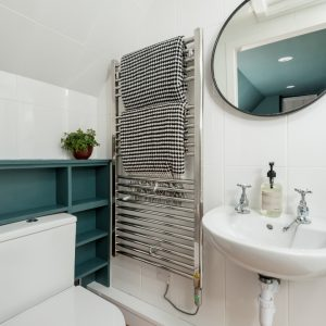 Inchrya blue by Farrow & Ball on painted shelving in shower room